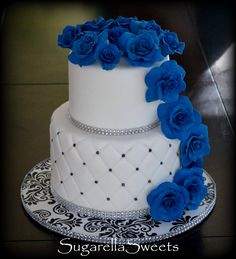 Beautiful wedding cascade cake with gumpaste roses and rhinestones. For more pictures go to www.SugarellaSweets.com