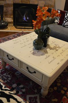 Springtime in Paris lettering stencil on top of coffee table. Stenciled furniture project by Ana Simpson of Dallas' Anabella Designs!