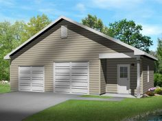 Two car garage with bay tall enough to accommodate an auto lift. Also includes separate work or storage area with bathroom.