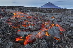Photograph Lava there comes by Денис Будьков on 500px Kamchatka. August 2013. The lava flow from the erupting volcano Tolbachik. In the background the volcano Udina.