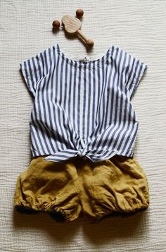 stripes and bloomers - so cute with leather sandals or mocs & a scarf headband. A cardigan could be added for chilly weather; even cable-knit tights & Mary Janes.