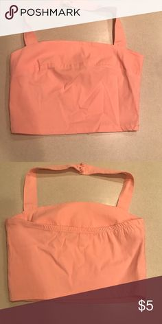 Charlotte Russe peach size medium halter top Cute summer peach halter top that buttons around the neck size medium. Great condition Charlotte Russe Tops Crop Tops