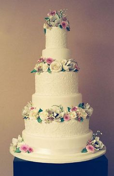 Signature wedding cake with sugar flowers by The White Flower Cake Shoppe