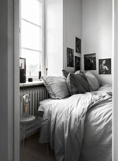Shades of grey in the bedroom of a beautiful, elegant small space apartment in Stockholm - Bo Sthlm.