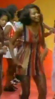 Love this striped dress from a 70s episode of Soul Train (photo is blurry due to YouTube quality but it appears at about 2:30 on the linked video).  Tons of great inspiration in the video--70s style is definitely having a moment.