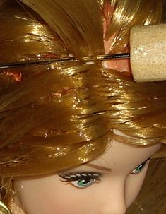 Reroot tutorial for doll hair from dollyhair.com: http://www.dollyhair.com/reroottutorial.htm#