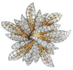 A Van Cleef & Arpels diamond brooch in gold, designed as a stylized flowerhead set with approximately 20 carats of brilliant cut diamonds, with textured gold accents. Turquoise Jewelry, Gemstone Jewelry, Bijoux Van Cleef And Arpels, Trendy Fashion Jewelry, Antique Brooches, Diamond Brooch, Fantasy Jewelry, Gold Flowers, Flower Brooch