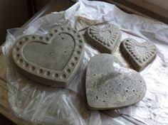 Concrete stepping stones using cake tins.