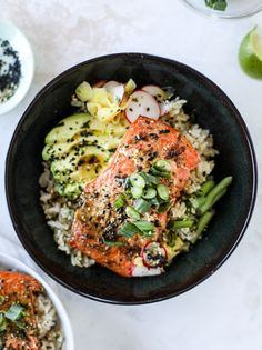 These butter salmon rice bowls are so full of flavor and intensely satisfying! The salmon is roasted with a dijon butter spread until it's flakey and buttery. Then it's piled on top of brown rice, sliced avocado, scallions and pickled ginger. Delicious!