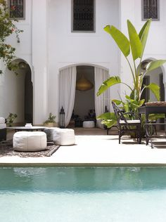 Terrace, Swimming Pool, White Walls, Curtains, Gold Lamp, and Plants