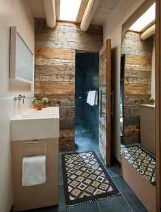 Hard to miss the magic of reclaimed wood in this space-conscious bathroom! [Design: R Brant Design]