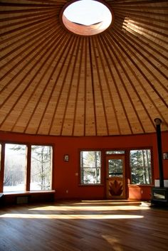 Smiling Woods Yurts of Twisp, Wash., sells kits for wooden yurtlike houses with prefabricated wall panels and metal roofs.
