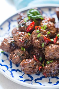 Super addictive and intensely flavorful thai spiced sticky basil meatballs recipe. Serve as appetizer or with jasmine sticky rice as main course.