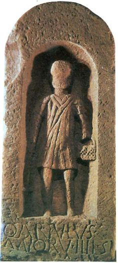 The gravestone of a Roman child-slave, Quintus Artulus. On the stone the four year old is holding the tools of a miner, an axe and a basket.