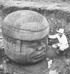 The Olmec colossal heads are at least seventeen monumental stone representations of human heads sculpted from large basalt boulders. The heads date from at least before 900 BC and are a distinctive feature of the Olmec civilization of ancient Mesoamerica.[1] All portray mature men with fleshy cheeks, flat noses, and slightly crossed eyes; their physical characteristics correspond to a type that is still common among the inhabitants of Tabasco and Veracruz.
