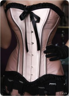 Corsets:  Pink Corset with Black Bow and Ruffles.