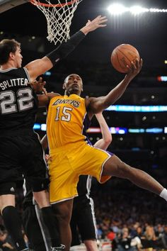 3211f1c34 APRIL 17  Metta World Peace goes to the basket against Tiago Splitter of  the San