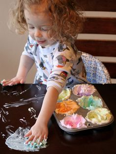 Paint the Table!  I was JUST telling a friend about this.  I used to color shaving foam and let the kids paint the tables around the house with it.  My house smelled great and my tables got clean....all while the kids had fun.