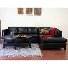 Have to have it. Wholesale Interiors Rohn Black Leather Sectional Sofa $1599.99