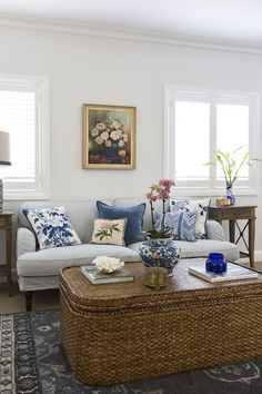 Love the blue and white ticking and cushions on the sofa