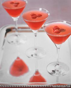 Rasmopolitan: 1 ounce citrus vodka + 1 ounce raspberry vodka + 1/2 ounce Chambord + 1 tablespoon freshly squeezed lime juice + 1 tablespoon simple syrup + 2 tablespoons cranberry juice + Raspberries for garnish