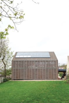 Modern bamboo-clad farmhouse with solar panels