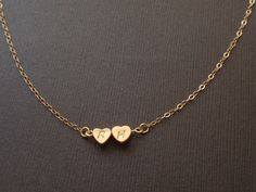Personalized Two Initial Mini Hearts 14k gold filled necklace Familly necklace, Love necklace by siemprejewelry on Etsy https://www.etsy.com/listing/155325477/personalized-two-initial-mini-hearts-14k