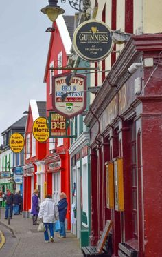 Colorful storefronts in Dingle, Ireland make this seaside town one of Europe's best small towns.  #travel #europe #ireland #dingle