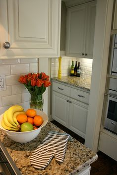 close-up of white cabinets w/ tan granite - like the wall color, granite and subway tile