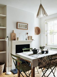 Beautifully Small Sara Emslie Rachel Whiting Remodelista (sage cafe chairs,teapot, floral tablecloth, white interior)