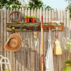 Great Idea!!!  finished project from How to Build a Spigot-Handle Tool Rack installed on a picket fence