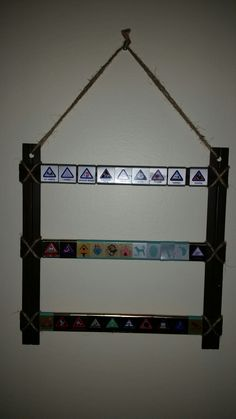 Cub Scout belt loop display. I painted 5 wood rulers and glued them together. Added twine for decoration.  My son loved it!!!