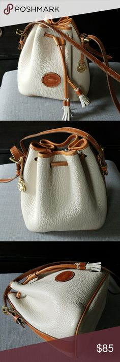 Dooney & Bourke Vintage Drawstring Bag R64 Dooney and Bourke Small vintage drawstring bag in a light taupe color. With British tan accents. All weather leather! Mark on bottom is a scuff.  Please ask any questions. Dooney & Bourke Bags Crossbody Bags