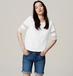 In soft cotton, this favorite tee gets all dressed up with femme lace trim. Round neck. Short sleeves.