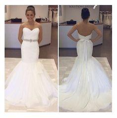 Our stylist wearing this simple but elegant @Alyne Tamir Manwaring Bridal dress. For more information, visit www.solutionsbridal.com