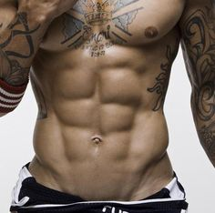 Look at those abs... http://activelifeessentials.com/health-and-fitness/ #fitness #abs #tattoos