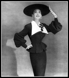 Dorian Leigh in suit by Lilli Ann, Vogue, March 1, 1953