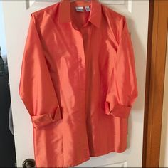 Silk Chico's blouse 100% silk Chico's blouse. Size 3x, excellent condition. Button down with cuffed sleeves. Button closure is hidden for a sleek look. Chico's Tops Button Down Shirts