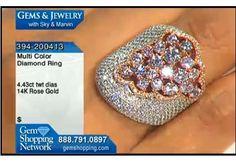 Over 4 carats of multi colored diamonds make this bling ring ravishing.