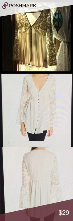 Ivory Lace Bell Sleeve Blouse NWOT bough and never wore, sleeves a little too short on my long arms. Absolutely beautiful, hate to give it up! Fits like a true junior medium.  Off white Victorian style Jolt Tops Blouses