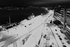 Dominik Geiger #dominikgeiger #stockholm #sweden #black #white #dark #snow #road #cars #winter #night #building #overexposed #river #ship #road
