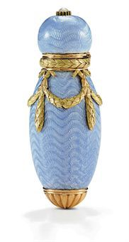 A Two-colour Gold and Guilloché Enamel Perfume Bottle Marked Fabergé with the workmaster's mark of Henrik Wigström, no town or date mark, circa 1908, indistinct scratched inventory number, possibly 228(?) Ovoid, enameled in translucent pale blue over a wavy guilloché ground, applied with chased laurel swags, the spherical hinged cover with pearl finial, in a fitted velvet Wartski case, marked inside cover.