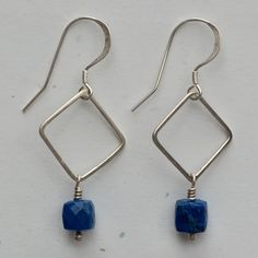 "Faceted lapis cubes suspended from hand fabricated sterling silver squares, sterling silver french hook ear wires, 1 3/4"" long."