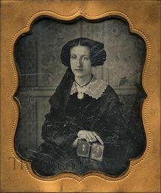 Woman With Daguerrotype of Loved One