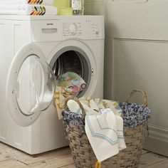 Laundry room with white washing machine, laundry products and wicker laundry basket House Cleaning Tips, Cleaning Hacks, Dry Cleaning, Dryer Vent Brush, White Washing Machines, Laundry Sorting, Laundry Hacks, Laundry Rooms, Real Simple