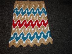 Crocheted multicolor zigzag pattern hippie skirt.