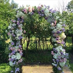 Thinking of summer and all the pretty things we get to design, like this floral archway in the lovely gardens of @graydonhall_couturecuisine #rachelaclingen #weddingdecor #weddingflowers #floralarch #flowers