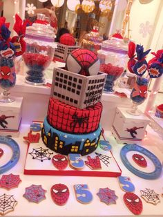 Spiderman birthday party cake and cookies See more party planning ideas at CatchMyParty.com!