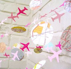 The Bon Voyage Air Plane Garland, Paper Garland, Pink, Maps, Ombre Pink, Multi colored, Maps. $12,00, via Etsy.