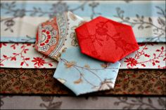 I am always looking for tips for paper piecing hexagons. I want them to look perfect with no stitches showing.
